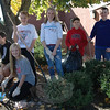 Members of this year's Student Council at Newtown Middle School spent time after school on Monday, October 22, working with rakes, shovels, and more during the group's annual Fall Beautification Day. From left, Kevin Arther, Emily Neave, Claire Beiter, Jayden Albrecht, Michael Arther, and Robert Hutchins work near the main entrance to the school. (Hallabeck photo)