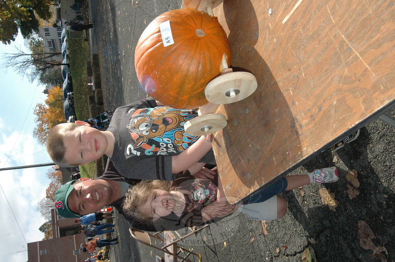 Addison, Brady, and father Matt Dennitt with their entry to the 3rd Annual Great Pumpkin Race hosted by the Newtown Lions Club on Saturday, October 20. (Hallabeck photo)