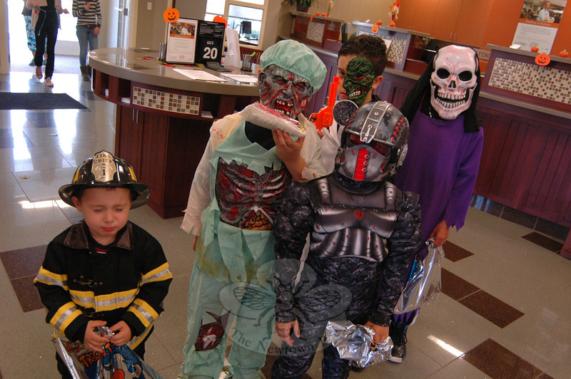 Trick or treaters at Union Savings Bank started their time at the Saturday, October 20, Plaza South Fall Festival, held at 266 to 275 South Main Street, by collecting bags to collect candy from among plaza shops before heading out to visit a Botsford Fire Rescue truck and more. The Newtown Animal Shelter also had an adoption event during the day, and there was live music and food. (Hallabeck photo)