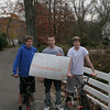 "Three teenagers who live in the Shady Rest neighborhood decided to make sure their friends and neighbors went out for Halloween Wednesday night. The boys — from left, Scott Martin, John DelRossi (holding the sign that says ""Shady Rest Halloween still on!"") and Curtis Williamson — created and then posted their sign at the top of Shady Rest Boulevard late Wednesday afternoon, hoping to catch the attention of as many people as possible as they returned from errands or work that afternoon. ""They can't cancel Halloween two years in a row,"" John said. ""Halloween is on!"" (Hicks photo)"
