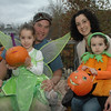 The Keane family of Sandy Hook participated in the Sandy Hook Halloween Walk in Sandy Hook Center on Saturday, October 27. Shown on the deck at the Stone River Grille are, from left, daughter Alexis, age 5; father David; mother Lisa; and daughter Paige, 22 months old.  (Gorosko photo)