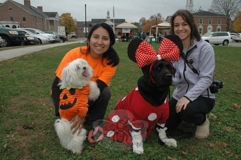 """Dogs were dressed for Halloween on Saturday, October 27, at Fairfield Hills as the town Parks and Recreation Department sponsored """"Howl-o-ween,"""" a fundraiser to benefit Newtown Park & Bark, a planned off-leash dog park. Shown, at left, are Catty Rebar and her Maltese-breed dog Lola, who was dressed as a pumpkin, and Theresa Viesto, and her black Labrador retriever Tehya, dressed as Minnie Mouse. (Gorosko photo)"""