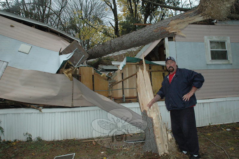 Bill McLean, a resident of the Meadowbrook Terrace Mobile Home Park at 55 Sugar Street (Route 302), stands next to a heavily damaged mobile home where a massive tree fell during Storm Sandy on Monday night. Mr McLean and another man rescued a woman resident of that mobile home, who was trapped inside the structure after the fallen tree burst into it. (Gorosko photo)