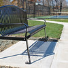 Members of the Newtown tennis community raised the majority of funds to purchase a bench honoring resident Sue Gardner, who has taught generations of Newtowners to love the game of tennis. Parks and Recreation workers installed the bench near the Dickinson Memorial Park tennis courts in mid-October. (Crevier photo)