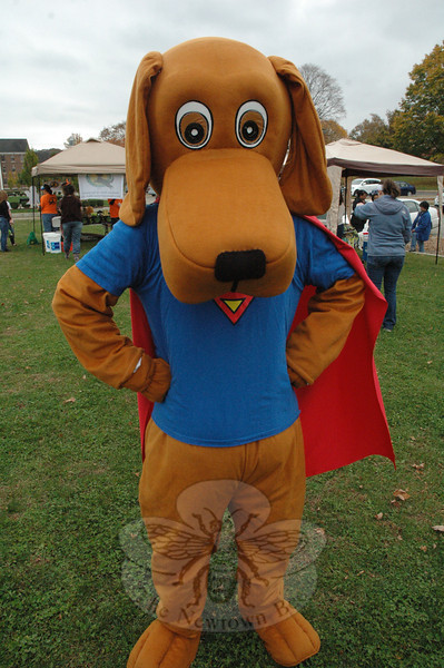 Patches reveals his true identity as Superdog at the Howl-o-ween fundraising event. (Gorosko photo)