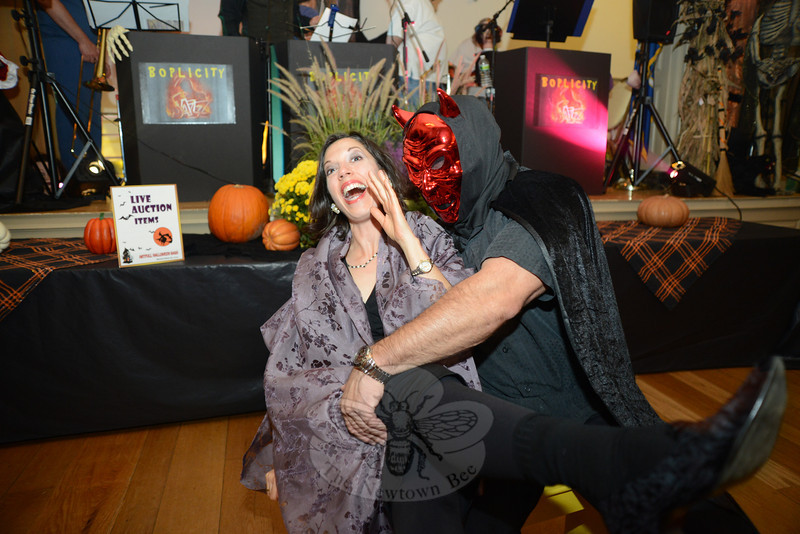 What a devil Rob Gisolfi turned out to be as he and Paula Elfont acted out a quick damsel-in-distress skit as they introduced artwork up for raffle Saturday, October 27, at the Alexandria Room during the ArtFULL Halloween Bash. Newtown United Inc presented the gala including raffled artwork, a silent auction, art sales, and more to benefit Ann's Place of Danbury, a cancer support services center, and Newtown's community food pantries. (Bobowick photo)