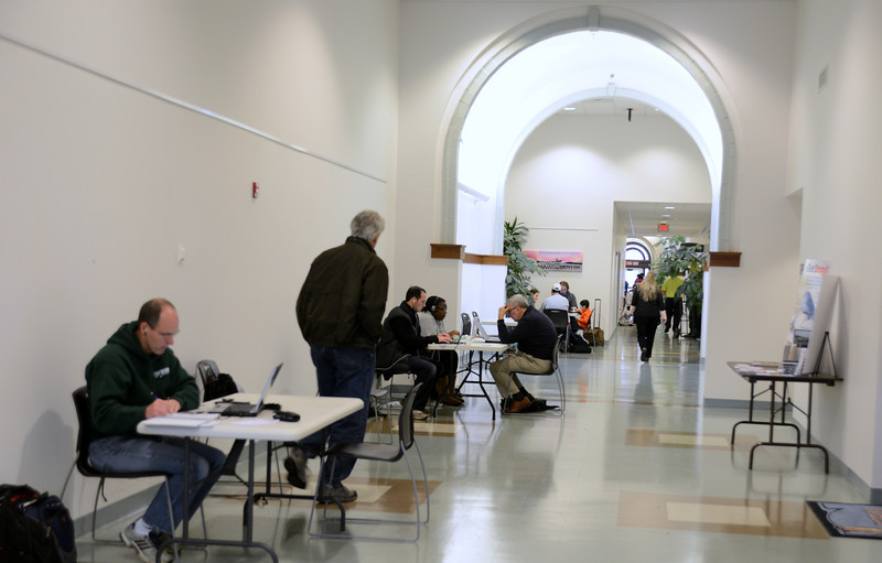 Newtown Municipal Center opened its doors to residents who needed to charge personal devices or work from their laptops this week. Many people filled the main hall and conference rooms. (Bobowick photo)