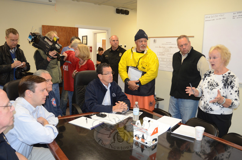 Congressman Chris Murphy, far left, and Governor Dannel Malloy, seated, listen as First Selectman Pat Llodra discusses the damage inflicted locally by Hurricane Sandy during a brief visit to Newtown's Emergency Operations Center Tuesday morning. Newtown was the governor's first stop in his tour of the state October 30. (Voket photo)