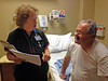 MAXINE GIVING ME DISCHARGE INSTRUCTIONS<br /> Here's one of my favorite nurses informing me what to do and not do in the weeks to come prior to my discharge. It was kind of a scary day, for both me and Lyn, as help wouldn't be just right there if needed. We would spend the next week in a motel here in Alpine, so we were at least close by.
