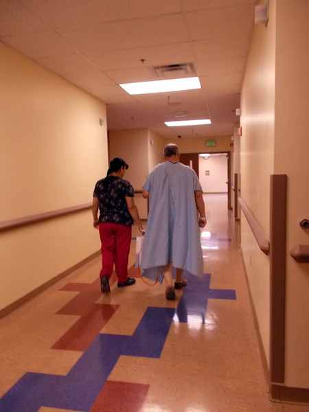 WALKING THE HALLS<br /> Eventually, the doc ordered me to take regular walks around the building to build up my strength. That took some doing right at first, but it sure beat laying around all day and night.