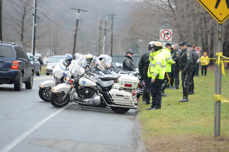 Motorcycle police from Trumbull, New Haven, Norwalk, and elsewhere lined up at the curb in front of St Rose of Lima Church Tuesday for an early afternoon funeral for one of the many victims from Sandy Hook School. (Bobowick photo)