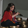 Jennifer Zulli, founder and director of Sound Center for Music, Creative Arts & Mindfulness, demonstrates the power of sound on a Tibetan singing bowl. An open gathering space on the upper level of the center will offer room for group programs and concerts, such as the Winter Solstice Sound Healing Event and Meditation scheduled for Friday, December 21. (Crevier photo)