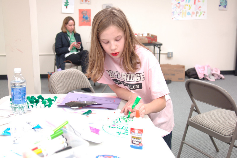 Anne Marie Carlson works on a crafts project this week at the Newtown Youth Academy, where no media were permitted. (Bobowick photo)