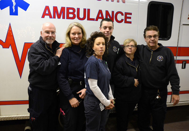 Newtown Ambulance Corp Members who were among the town's first emergency responders to Friday morning's shootings in Sandy Hook made themselves available for media interviews December 19. Among those responders to initial calls for help from Sandy Hook School were, from left, Mike Collins, Sharon McCarthy, Jill Urciuoli, Jordan Rees, Cathy Dahlmeyer, and Ray Beach. (Bobowick photo)
