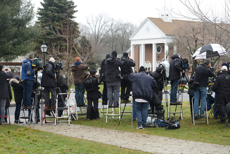 Despite the private grieving of parents and friends attending funerals this week for the shooting victims, national media covered the services live. Police tape kept cameramen and photographers clear as families mourn. (Bobowick photo)