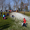 A few hours before Mother Nature turned on her own snow machine Christmas Eve, dozens of children had plenty of reasons to laugh and squeal as they made the best of a small smoosh of manmade snow generated by volunteers at Treadwell Park. Even though the thin layer barely covered a small patch of hillside, it did not deter most the participating children from heading up the hill for run after run. Organizers are also promising additional manmade sledding opportunities at the park in the event the latest covering of snow melts away too soon. (Voket photo)
