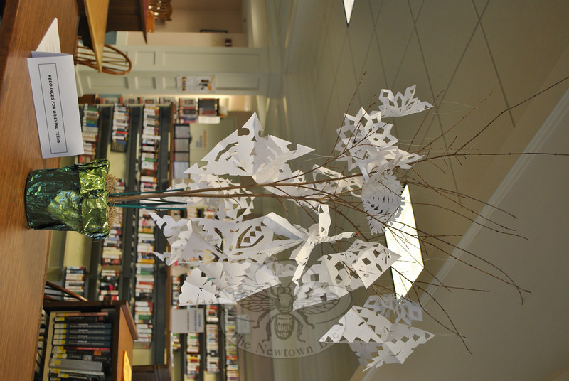 YAC members made paper snowflakes as part of a subdued holiday gathering, Monday, December 17, following a time of silence and sharing feelings about the December 14 shootings at Sandy Hook School. Crevier photo)