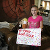 "Middle Gate student Jennah Guarna created a special poster to hang on her front door on December 15. With help from some friends (""They helped me with a lot of the stickers,"" the 7-year-old said), Jenna put the words ""We Pray For Sandy Hook"" on a piece of white poster board using red letter stickers, and then filled the remaining space with hearts, flowers, smiley faces, flowers, and countless animals. ""I made it because some of the kids, they were all nice. One of my friends had two friends on the swim team who passed away [on December 14]. I thought I would make a poster to cheer her up,"" said Jennah. ""When she saw this after I finished it, she had a big smile. I want everyone to smile. I want Newtown to smile again."" Her sign, said mom Joanna, has been hung on the front door of their home. Jennah is shown with Brownie, far left, and Spirit, two horses she picked from the donations of stuffed animals that have been delivered to The Bee to share. (Hicks photo)"
