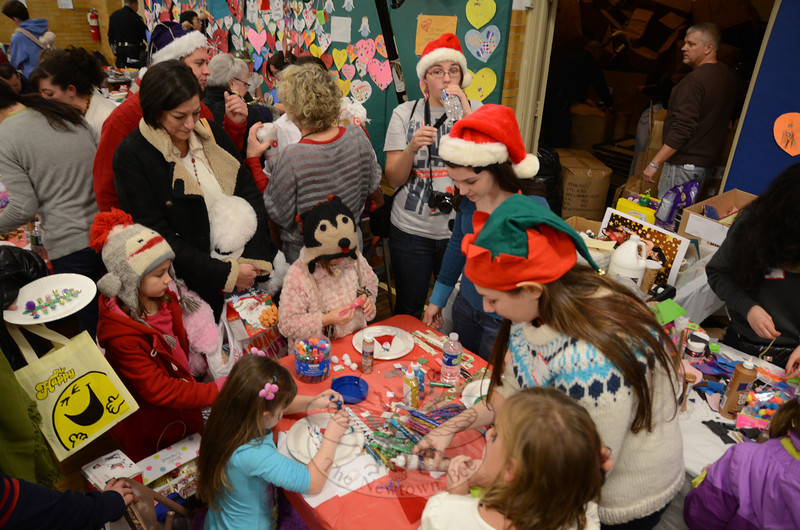 While volunteers provided face painting and juggling lessons, visitors to a townwide toy giveaway at Edmond Town Hall were greeted by this small but solemn reminder of those who lost their lives during a December 14 shooting rampage at Sandy Hook School. (Voket photo)