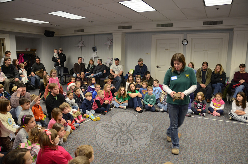 One of Newtown's first attempts to try and divert the attention of especially young children from the emotional aftereffects of the Sandy Hook School shooting appeared to be a great success, as representatives of the Woodcock Nature Center of Darien volunteered to entertain little ones and their parents with a number of live animals on display at the Booth Library on December 22. Center director Henryk Teraszkiewicz and Woodcock staffer Allison Ericson kept dozens of children entertained with critters, including a huge spotted salamander and a native box tortoise. (Voket photo)
