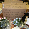 Volunteers and officials sorting through the thousands of donations occasionally find simple gestures of support and tribute like this one from Oklahoma which contained a couple of notes of support, some silk roses and a teddy bear. (Voket photo)
