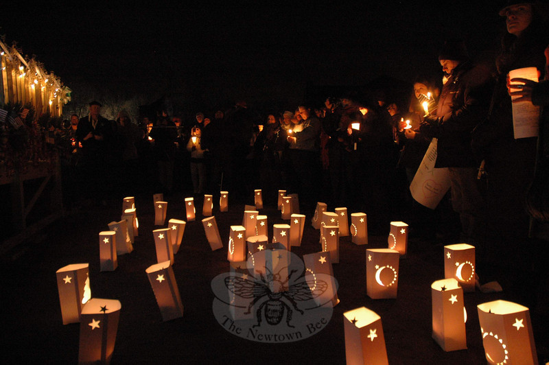 A field of luminarias, which commemorated the people who lost their lives in the December 14 shooting incident at Sandy Hook Elementary School, stood near the mourners at a December 21 candlelight vigil at Fairfield Hills.  (Gorosko  photo)