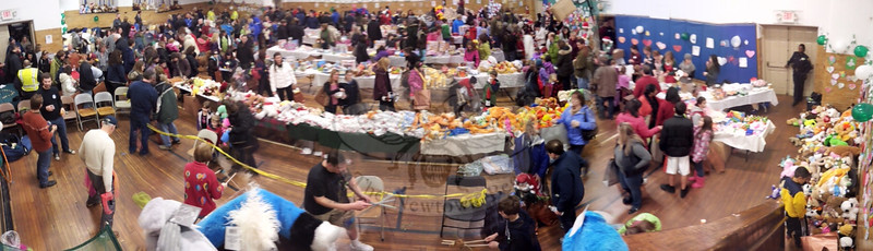 This panoramic shot illustrates the wall to wall sea of toys, games and, food made available to all Newtown children and their guests December 22. This was the first of what might be several events to help reduce the volume of toys and goods streaming into town in memory of the Sandy Hook School shooting victims, which included 20 first graders. (Voket photo)