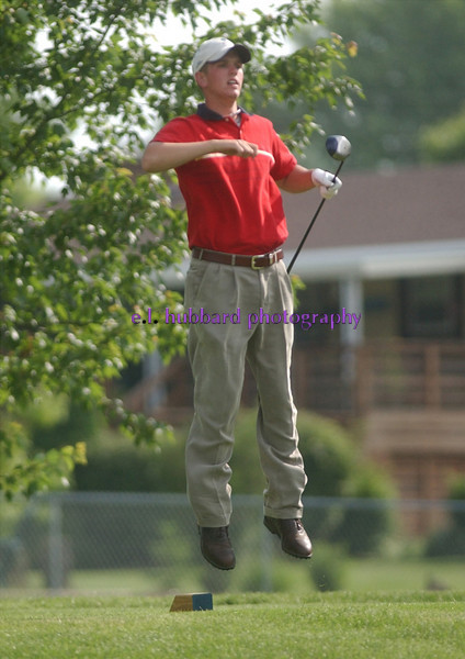 E.L. Hubbard/Journal-News<br /> Eric Wyrick jumps to keep his tee shot from 16 in view.