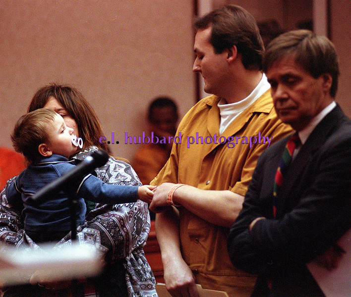 E.L. Hubbard/Journal-News<br /> Two-year-old Draven reaches for his father, James Neil Howard, at Howard's sentencing hearing Thursday. Howard was sentenced to seven years in prison for abusing the boy. The mother, Angelique Howard (left) said Draven's injuries are improving. Defense attorney Michael Shanks (far right) plans to appeal.