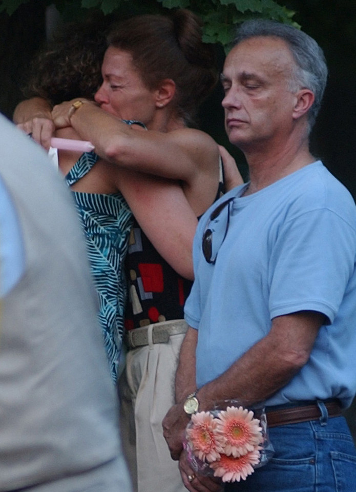 E.L. HUBBARD/JOURNALNEWS<br /> Two ladies embrace during the memorial service for Sherry Corbett as another person closes his eyes.