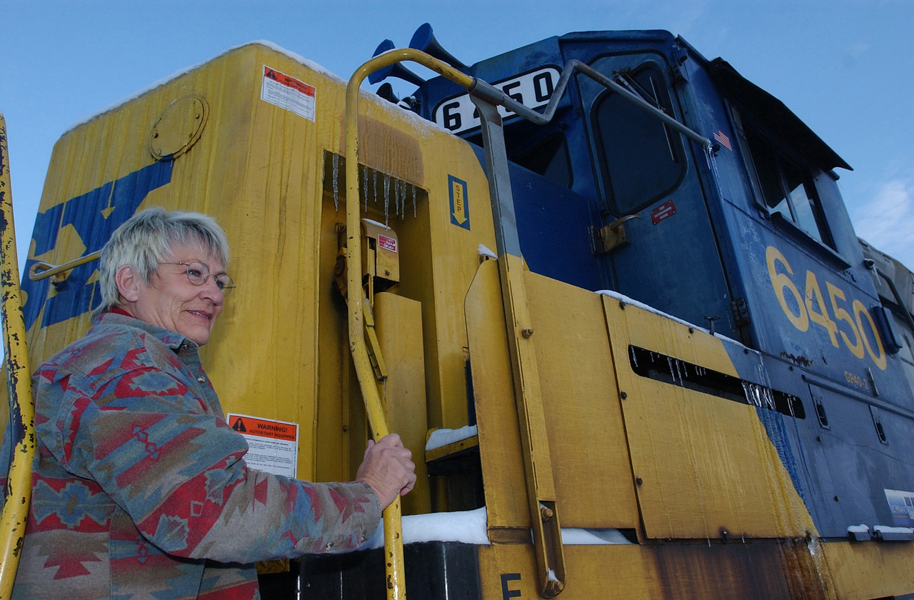 E.L. HUBBARD/JOURNALNEWS<br /> Jacky Clark pauses on the steps of a locomotive at the New Miami CSX New River Yards Thursday, 12/05/02.  Clark is an engineer who is retiring after 30 years on the tracks, 23 as an engineer.