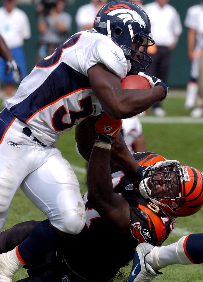 Denver Broncos running back Mike Anderson runs into Cincinnati Bengals defensive tackle John Thornton in the second half at Paul Brown Stadium Sunday, 9/07/03.