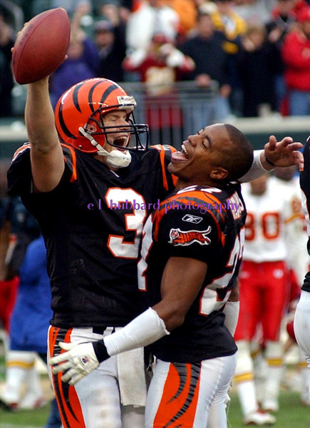 Bengals quarterback Jon Kitna and cornerback Artrell Hawkins celebrate their victory over Kansas City at Paul Brown Stadium Sunday, 11/16/03.