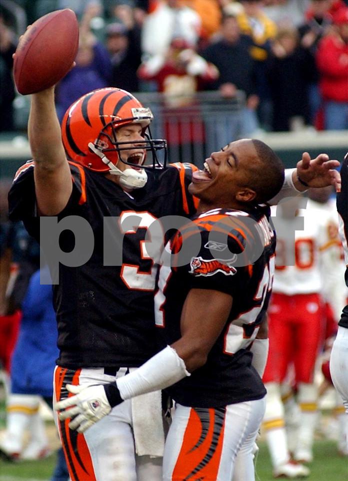Bengals quarterback Jon Kitna and cornerback Artrell Hawkins celebrate their victory over Kansas City at Paul Brown Stadium Sunday, 11/16/03.
