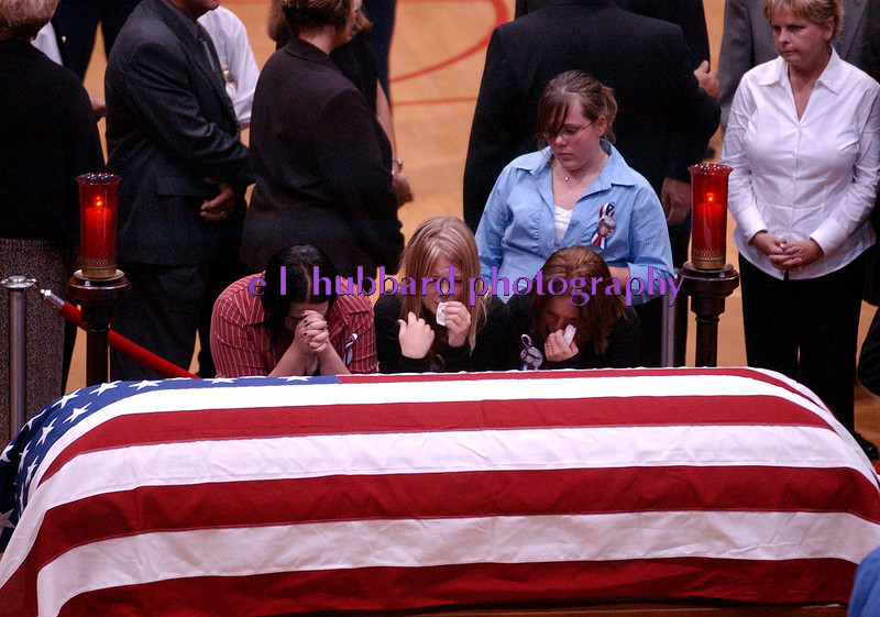 E.L. HUBBARD/JOURNALNEWS <br /> Members of Lance Cpl. Timothy Bell, Jr.'s family mourn at the casket of Lance Cpl. Michael Cifuentes in the arena at Fairfield High School Sunday, 08/14/05. The Bell family came directly from funeral services for Bell at Lakota East High School.