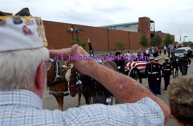 E.L. HUBBARD/JOURNALNEWS<br /> A war veteran salutes as the caisson carrying the body of Lance Cpl. Timothy Bell, Jr. stops in front of Lakota East High School in Liberty Township for Bell's funeral Sunday, 08/14/05.