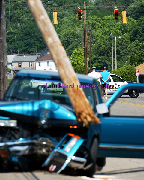 The driver of a blue pickup is taken into custody after crashing into a telephone pole on Ludlow Ave. near South Second St. Tuesday, 06/21/05.<br /> Photo by E.L. HUBBARD