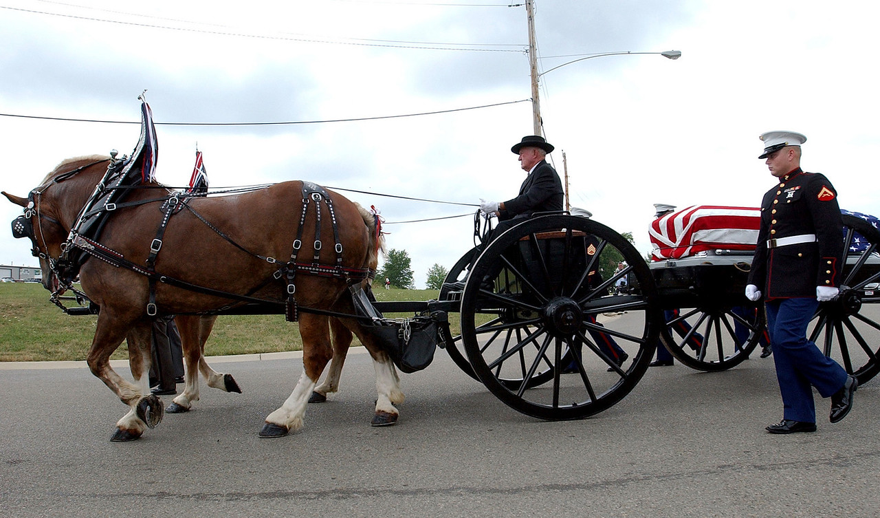 E.L. HUBBARD/JOURNALNEWS<br /> The caisson carrying the body of Lance Cpl. Timothy Bell, Jr. makes it's way to Lakota East High School in Liberty Township for Bell's funeral Sunday, 08/14/05.