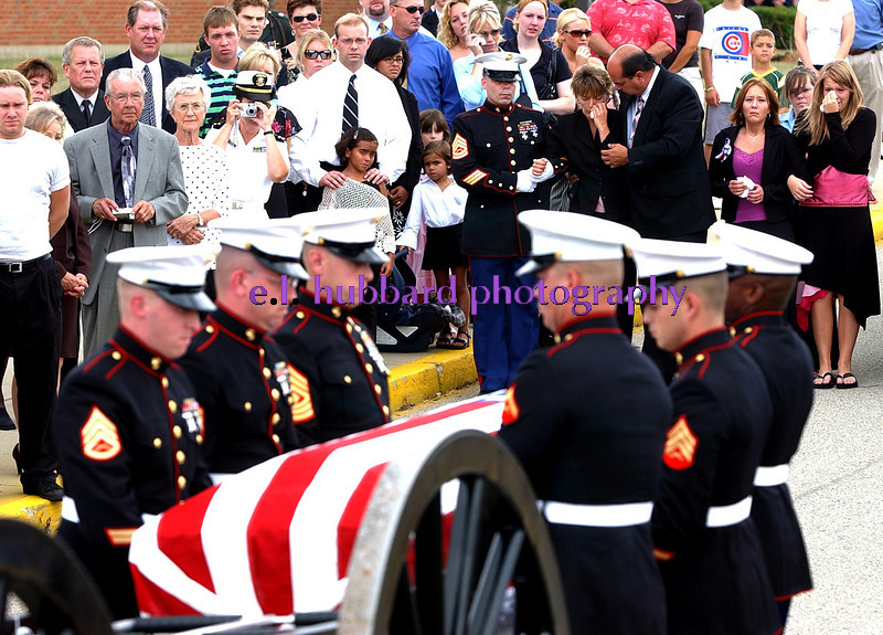 E.L. HUBBARD/JOURNALNEWS<br /> The mother of Lance Cpl. Timothy Bell Jr., is overcome with emotion as Bell's casket is lifted from the caisson in front of Lakota East High School in Liberty Township Sunday, 8/04/05. The funeral was held inside the school, and burial will be Tuesday, 8/16/05 in Arlington National Cemetery.