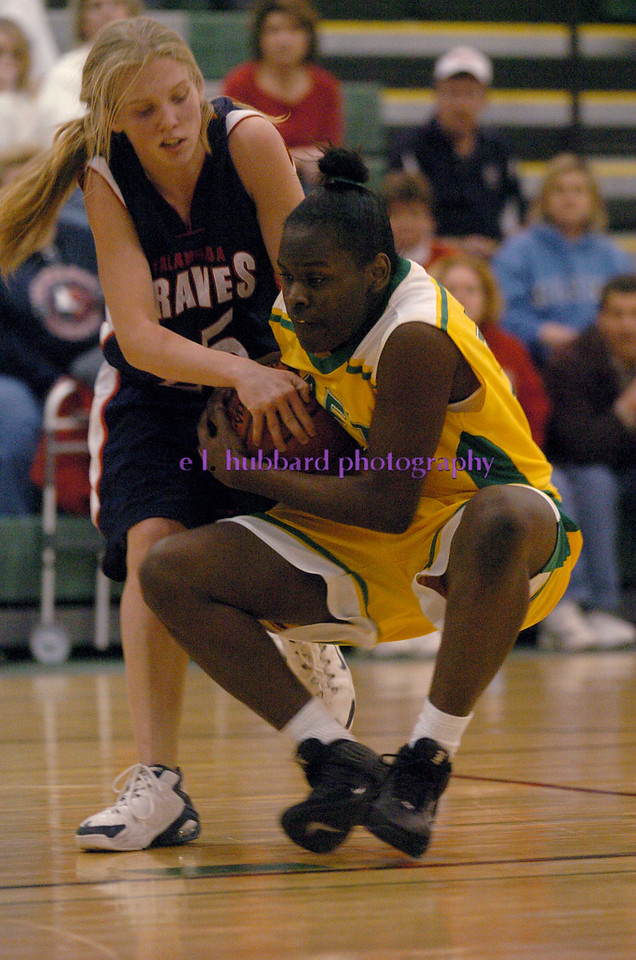 E.L. HUBBARD/JOURNALNEWS<br /> Talawanda Kristen Richardson and Taft forward Ebony Lewis tangle over possession in the third quarter of their sectional tournament final at Mason Middle School gym Friday, 02/24/06.