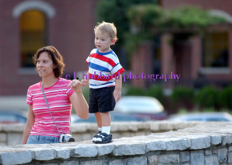 Mary Beth Lohmueller walks her son, Isaac, 2, on the stone bridge surrounding the pond at Village Green Thursday, 7/13/06. Lohmueller and her husband, Steve, and son Benjamin, 4, were visiting the area from Reading for the concert and ice cream. Staff photo by E.L. Hubbard