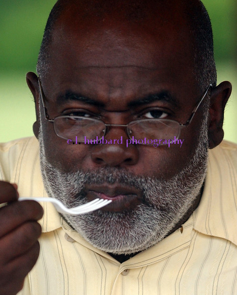 Winfred Burns((cq)) concentrates as he tastes an apple pie he was judging for the 4th of July Festival Tuesday, 07/04/06. Staff photo by E.L. Hubbard