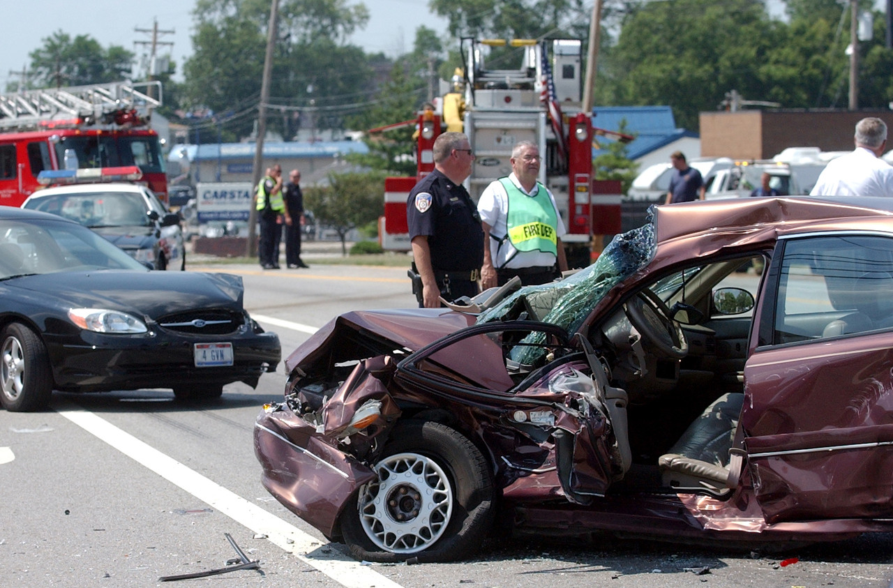 Fairfield rescue personnel investigate the scene of an accident on Ohio 4 at Michael Lane involving two automobiles and a fire truck Wednesday, 08/02/06. One person was transported by Air Care helicopter. Staff photo by E.L. Hubbard