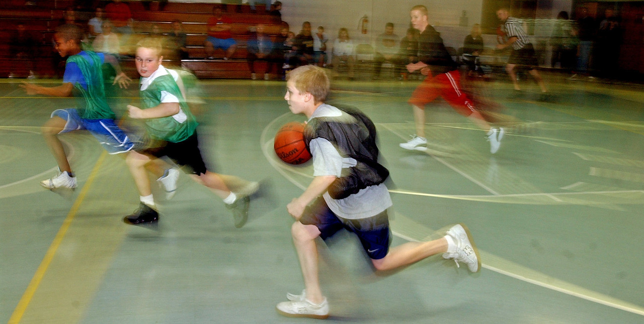 Shane Owens((CQ)), 11, takes the ball upcourt for his team as opponent Drew Riddick((CQ)), 10, (left) keeps an eye on him during a game at the Salvation Army((CQ)) Monday, 11/27/06. Staff photo by E.L. Hubbard