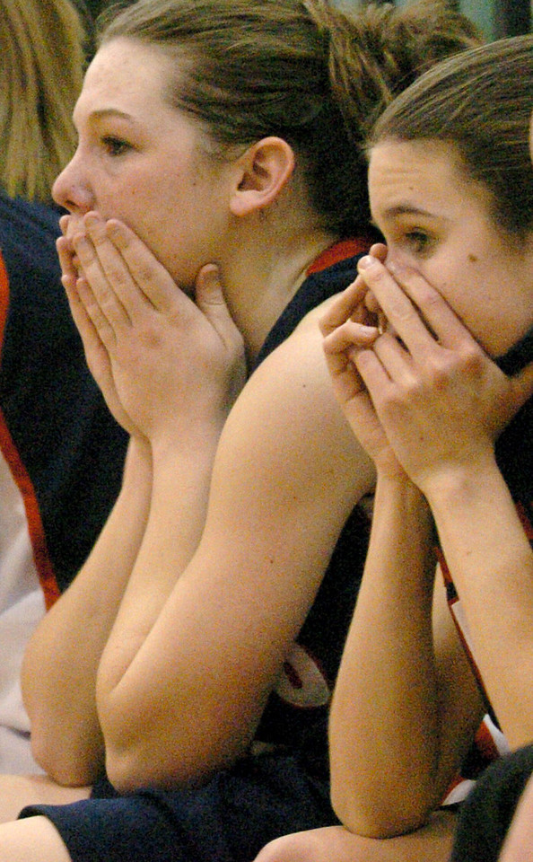 E.L. HUBBARD/JOURNALNEWS<br /> Apprehensive faces are seen on the Talawanda bench as the girls go down in overtime to Taft in their sectional tournament final at Mason Middle School gym Friday, 02/24/06.