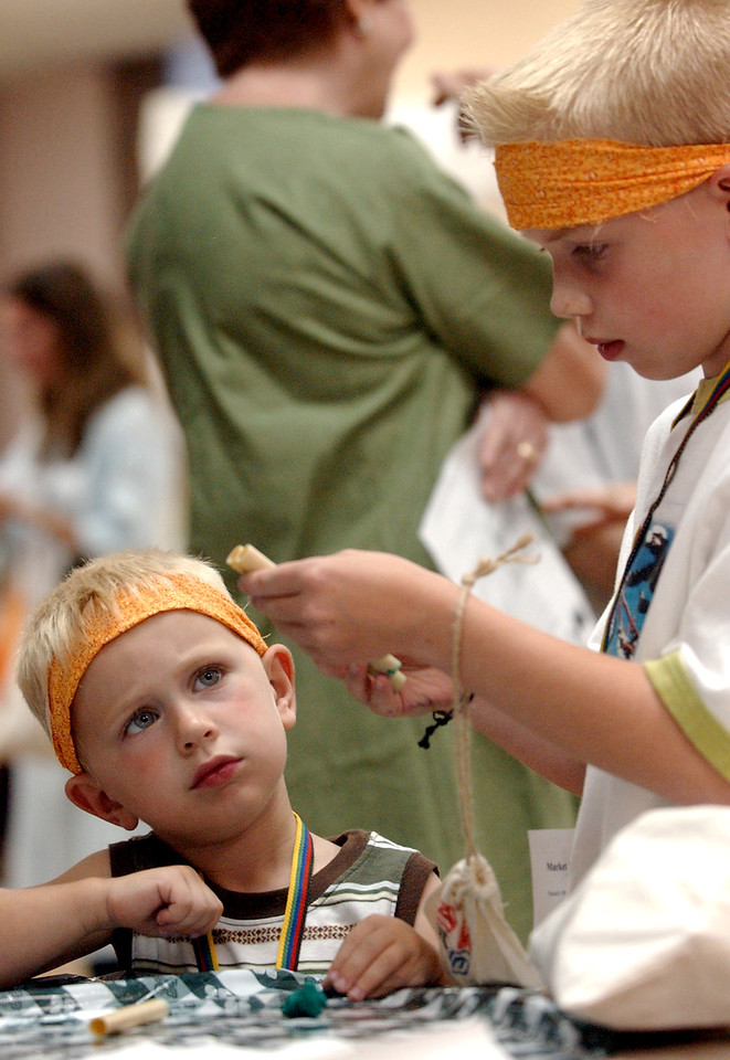 Nathan Garrison((cq)), 3, watches intently as his cousin, Jake Palmer((cq)), 8, builds a pan flute for him during Holyland Adventure Bethlehem Village((cq)) vacation bible school at Lindenwald United Methodist Church((cq)) Wednesday, 06/21/06. Staff photo by E.L. Hubbard