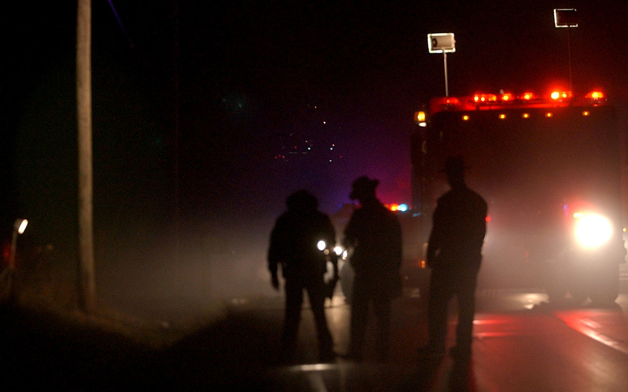E.L. HUBBARD/JOURNALNEWS<br /> Butler County sheriff's deputies and Hanover Township rescue personnel investigate the scene on Hamilton Richmond Rd. where a pedestrian was struck in Hanover Township Tuesday, 01/10/06.