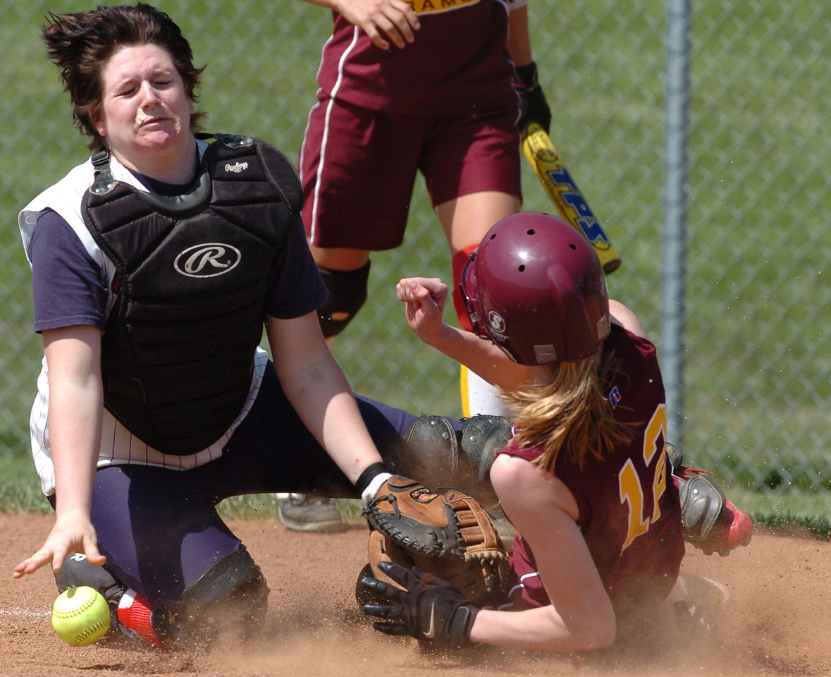 E.L. HUBBARD/JOURNALNEWS<br /> Ross baserunner Megan Ellinghausen (12) slides safely home as Talawanda catcher Julia Lance can't handle the throw in the fifth inning at Ross High School softball field Tuesday, 04/18/06.