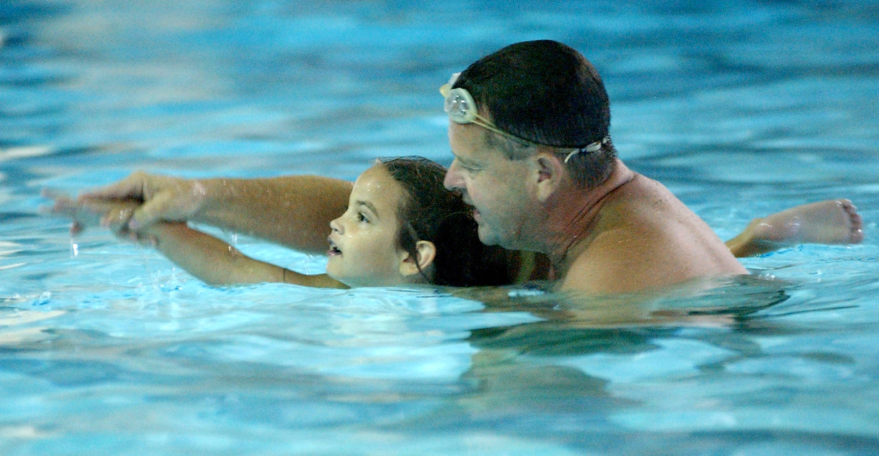 Mike Day((cq)), a YMCA volunteer, teaches Mackenzie Turner((cq)), 5, to swim at the Fitton Family YMCA((cq)) Wednesday, 06/28/06. Staff photo by E.L. Hubbard