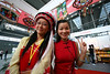 A student from Shenzhen University dressed in traditional Baizu clothing and Fiona Wan from Jiangxi pose for the camera